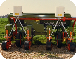 Microgranule applicator for large-scale crops